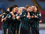 Patrick Bamford celebrates with teammates after scoring for Leeds United against Aston Villa in the Premier League on October 23, 2020