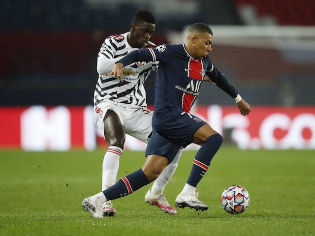 Paris Saint-Germain's Kylian Mbappe in action with Manchester United's Axel Tuanzebe in the Champions League on October 20, 2020