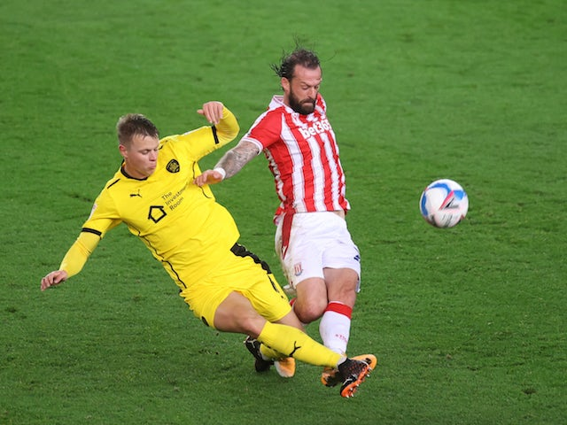 Stoke City's Steven Fletcher in action with Barnsley's Mads Andersen in the Championship on October 21, 2020