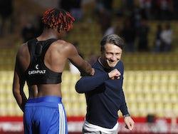 Strasbourg defender Mohamed Simakan touches elbows with Monaco boss Niko Kovac in September 2020