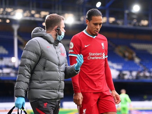 Liverpool defender Virgil van Dijk walks off injured during the Merseyside derby against Everton on October 17, 2020