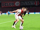 Ajax's Perr Schuurs in action against Liverpool in October 2020