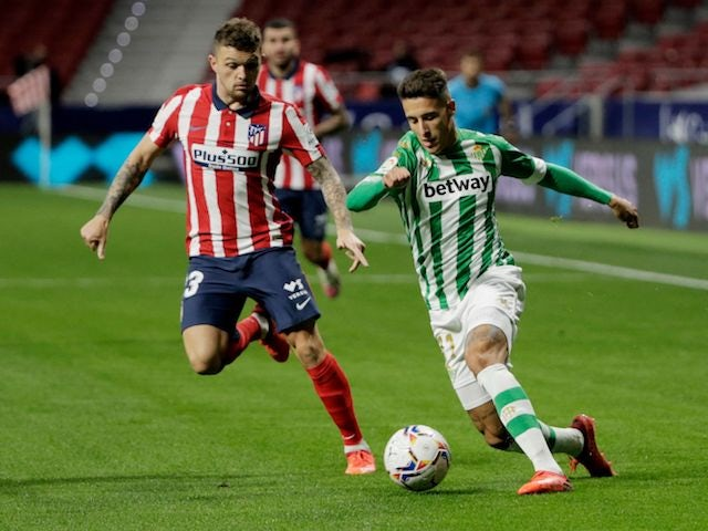 Atletico Madrid's Kieran Trippier in action with Real Betis' Cristian Tello in La Liga on October 24, 2020
