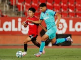 Barcelona defender Ronald Araujo in action with Mallorca's Takefusa Kubo in June 2020