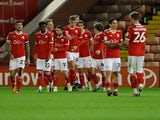Barnsley's Conor Chaplin celebrates with teammates after scoring against QPR in the Championship on October 27, 2020