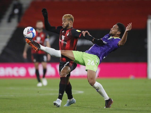 Bournemouth's Joshua King in action with Bristol City's Zak Vyner in the Championship on October 28, 2020