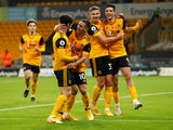 Daniel Podence celebrates scoring for Wolverhampton Wanderers against Crystal Palace with teammates in the Premier League on October 30, 2020