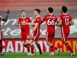 Diogo Jota celebrates scoring for Liverpool against West Ham United with teammates on October 31, 2020