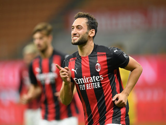 Hakan Calhanoglu celebrates scoring for Milan on September 24, 2020