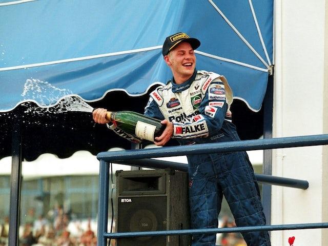 Jacques Villeneuve celebrates winning the 1997 F1 world title
