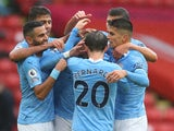 Kyle Walker celebrates with teammates after scoring for Manchester City against Sheffield United in the Premier League on October 31, 2020