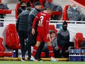 Liverpool's Fabinho trudges off after suffering an injury against FC Midtjylland in the Champions League on October 27, 2020