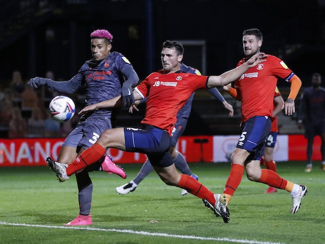 Luton Town's Tom Lockyer in action with Nottingham Forest's Lyle Taylor in the Championship on October 28, 2020