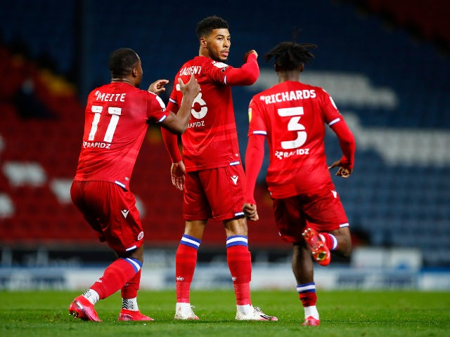 Reading's Josh Laurent celebrates with teammates after scoring against Blackburn Rovers in the Championship on October 27, 2020