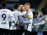 Swansea City's Jay Fulton celebrates with teammates after scoring againt Stoke City in the Championship on October 27, 2020