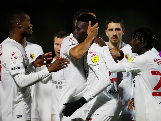 Watford's Ismaila Sarr celebrates with teammates after scoring against Wycombe Wanderers in the Championship on October 27, 2020