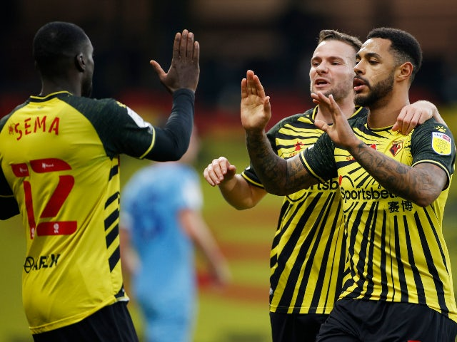 Andre Gray celebrates with teammates after scoring for Watford against Coventry City in the Championship on November 7, 2020