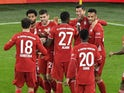 Bayern Munich players celebrate after Robert Lewandowski scores against Borussia Dortmund on November 7, 2020
