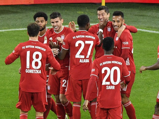 Bayern Munich players celebrate after Robert Lewandowski scores against Borussia Dortmund on November 7, 2020