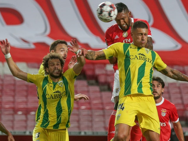 Tondela players challenge for the all against Benfica in June 2020