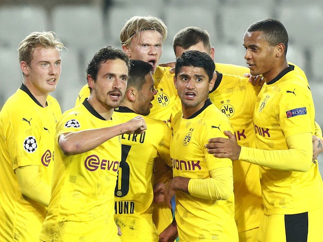 Borussia Dortmund's Erling Braut Haaland celebrates with teammates after scoring against Club Brugge on November 4, 2020