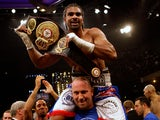 David Haye celebrates after beating Nikolai Valuev on November 7, 2009