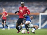 Manchester United's Paul Pogba in action with Everton's Allan in the Premier League on November 7, 2020