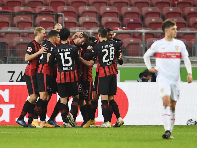 Eintracht Frankfurt's David Abraham celebrates with teammates after scoring against Stuttgart on November 7, 2020
