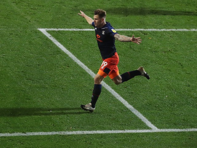 Luton Town's James Collins celebrates scoring against Rotherham United on November 4, 2020