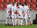 Slavia Prague's Jan Kuchta celebrates with teammates after scoring against Nice on November 5, 2020