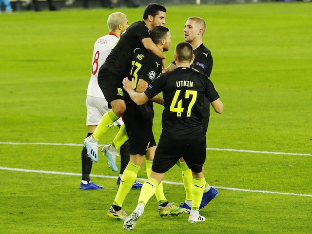 Krasnodar's Marcus Berg celebrates with teammates after scoring against Sevilla on November 4, 2020