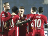 Liverpool players celebrate scoring against Atalanta in the Champions League on November 3, 2020