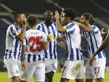 Porto players celebrate scoring against Marseille in the Champions League on November 3, 2020