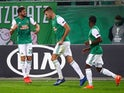 Rapid Vienna players celebrate scoring against Arsenal in October 2020