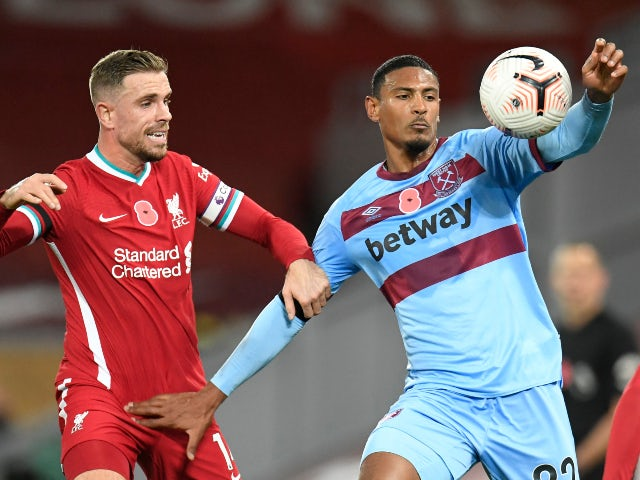 West Ham's Sebastien Haller in action with Liverpool's Jordan Henderson on October 31, 2020