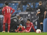 Liverpool defender Trent Alexander-Arnold receives treatment for an injury on November 8, 2020