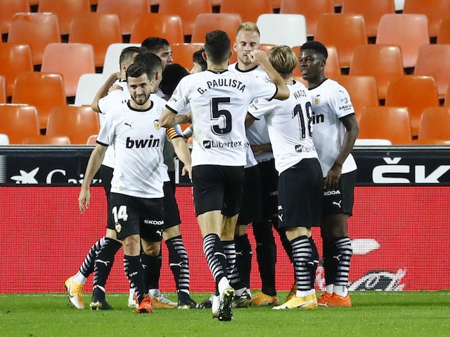 Valencia players celebrate Carlos Soler's goal against Real Madrid on November 8, 2020