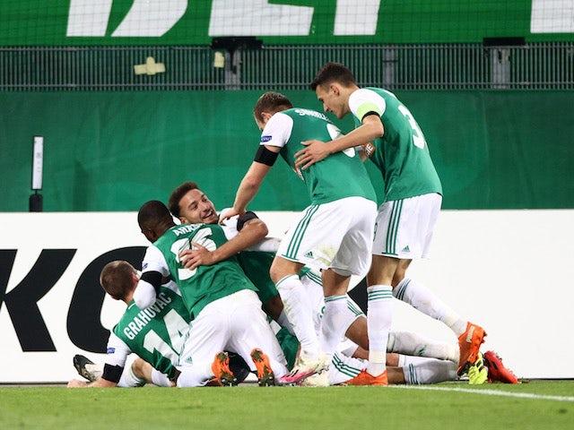 Rapid Vienna's Maximilian Hofmann celebrates with teammates after scoring against Dundalk on November 5, 2020