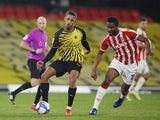Watford's Joao Pedro in action with Stoke City's John Obi Mikel in the Championship on November 4, 2020
