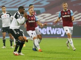 West Ham United players celebrate after Fulham's Ademola Lookman misses a penalty in their Premier League clash on November 7, 2020