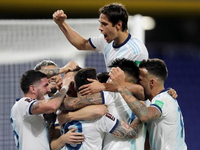 Argentina players celebrate scoring against Paraguay on November 13, 2020