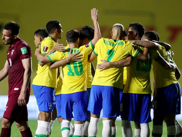 Brazilian players celebrate Roberto Firmino's goal against Venezuela on November 14, 2020
