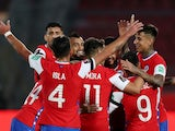 Chile players celebrate scoring against Peru on November 13, 2020