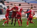 Chorley players celebrate after Connor Hall scores against Wigan Athletic in the FA Cup on November 8, 2020