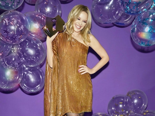 Record-breaking Kylie Minogue beats Little Mix to albums top spot