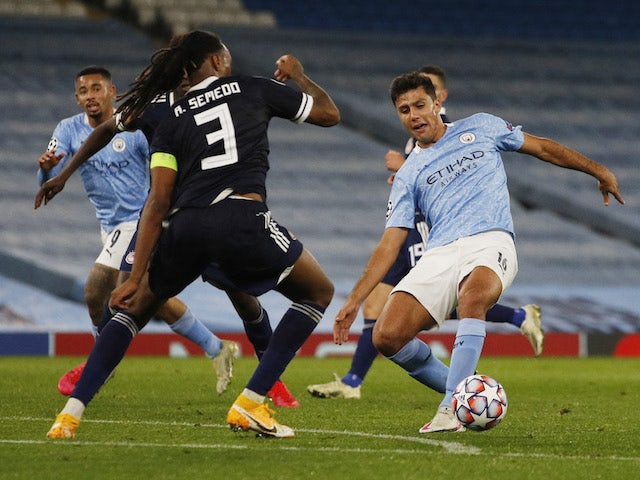 Manchester City's Rodri in action with Olympiacos' Ruben Semedo in the Champions League on November 3, 2020