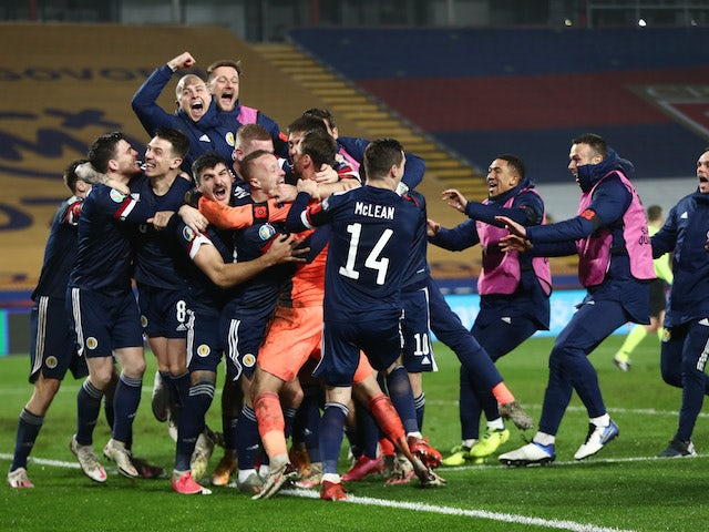 Scotland players celebrate after beating Serbia on penalties in their Euro 2020 playoff on November 12, 2020