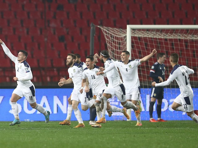 Serbia players celebrate scoring against Scotland on November 13, 2020