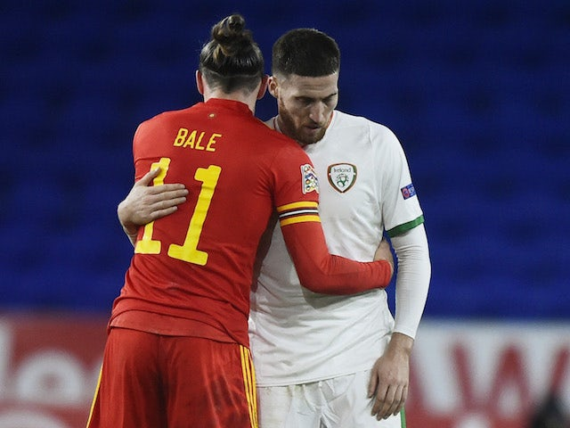 Wales' Gareth Bale and Republic of Ireland's Matt Doherty embrace after the UEFA Nations League clash on November 15, 2020