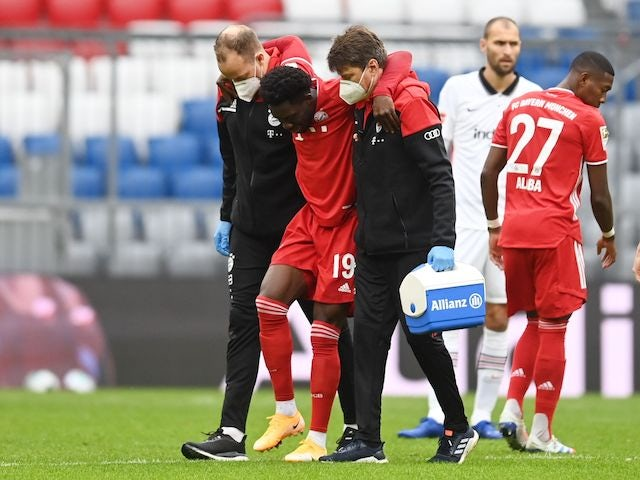 Bayern Munich defender Alphonso Davies is carried off injury in October 2020